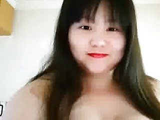 Fat Chinese whore playing with her tits 2