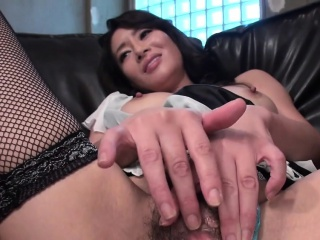 Asian floozie pokes her fat fist flaps with big dildo
