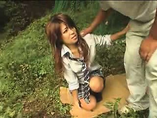 Asian babe to a hot outdoor blowjob