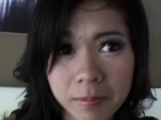 Amateur Thai babe sucks man's dick