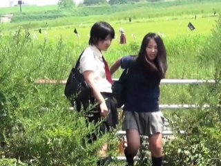 Teens peeing in field