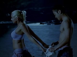 Chinese man and white girl on hammer away beach (2007)