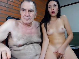 Old man with asian girl