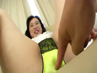 Asian milf shows her goods to her roasting young board