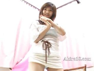 Cute mongolian girl teasing herself