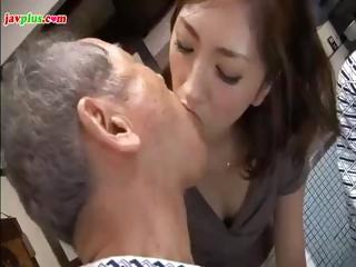 Young Asian daughter serves cur� and his collaborate then gives him a tidy